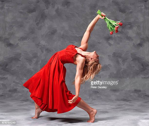 bent over dancer with red tulips - beautiful women bent over stock photos and pictures