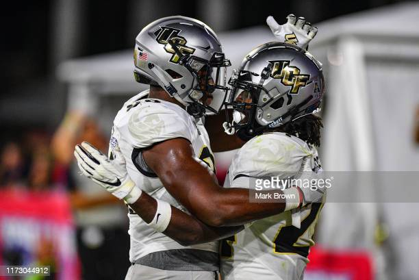 Bentavious Thompson of the UCF Knights scores a touchdown in the second half against the Florida Atlantic Owls at FAU Stadium on September 07 2019 in...