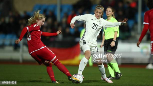 Bente Fischer of Germany and Signe Carstens of Denmark compete for the ball during the U16 Girls international friendly match betwwen Denmark and...