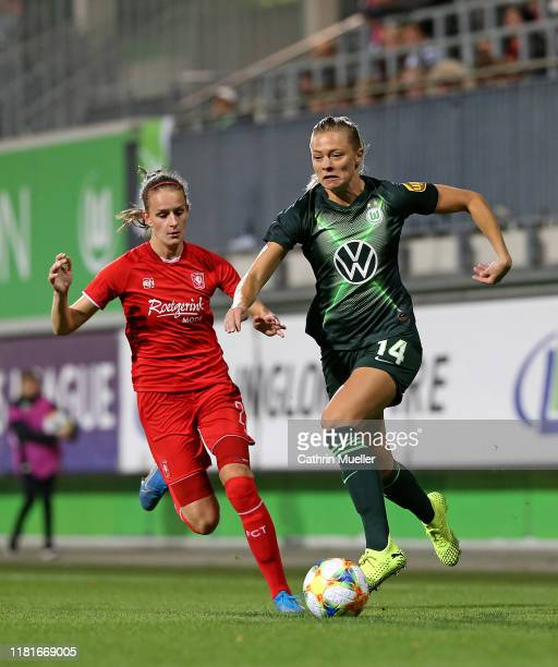 Bente Jansen of FC Twente Enschede and Fridolina Rolfoe of VfL Wolfsburg battle for the ball during the UEFA Women's Champions League Round of 16...