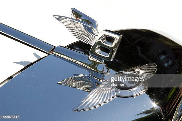 bentley badge and hood ornament in sunlight closeup - hood ornament stock pictures, royalty-free photos & images