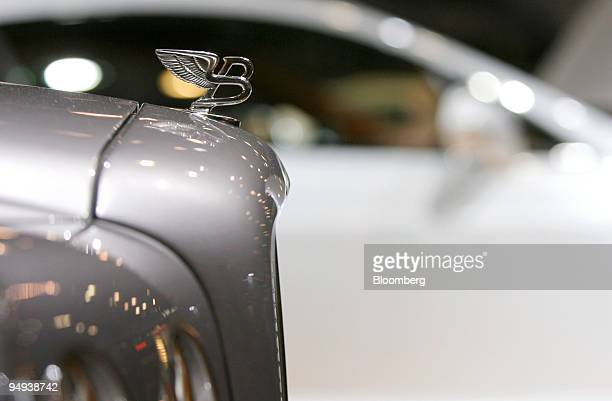 Bentley badge sits on the hood of a 2010 Continental Supersports during a media preview of the 2009 New York International Auto Show in New York US...