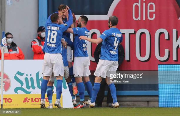 Bentley Baxter Bahn of Rostock celebrates with teammates after scoring his team's first goal after penalty during the 3. Liga match between Hansa...