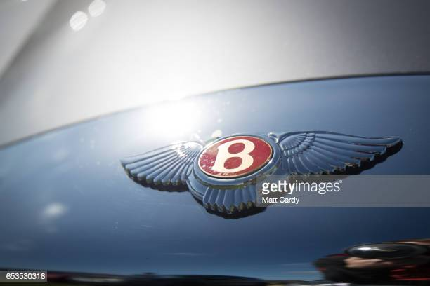 Bentley car is parked in the car park as racegoers arrive at the Cheltenham Racecourse on Ladies Day the second day of the Cheltenham Festival on...