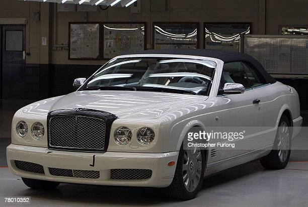 Bentley car sits inside a light tunnel and undergoes final preparation and inspection in the Mulliner workshop at the Bentley Motors Factory on 19...