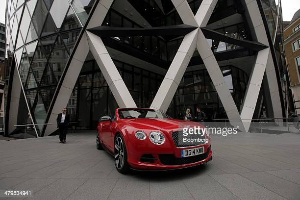 A Bentley Continental GT convertible automobile produced by Bentley Motors Ltd stands outside 30 St Mary Axe also known as 'the Gherkin' following a...