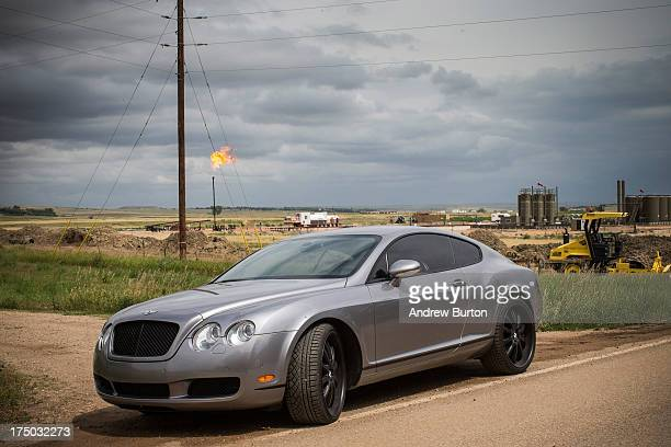 Bentley Continental GT is parked on the side of the road in Watford City North Dakota North Dakota has been experiencing an oil boom in recent years...