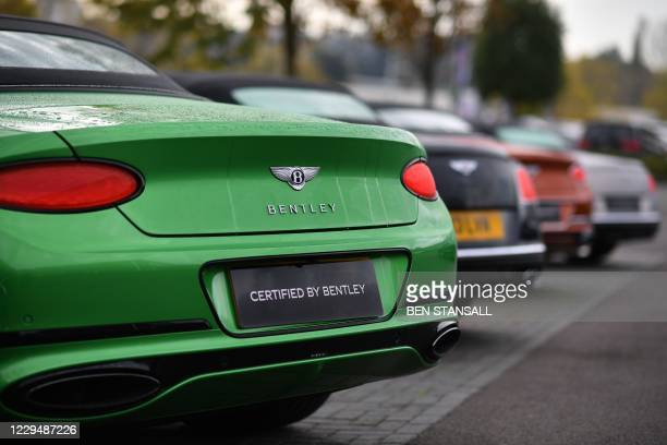 Bentley luxury cars are seen outside a garage in Tunbridge Wells, south-east of London on November 6, 2020. - Bentley have announced their intention...