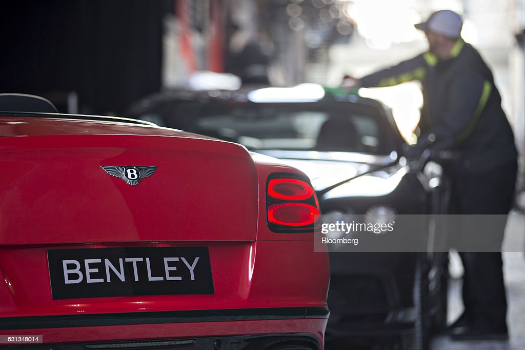 A Bentley Motors Ltd. 2017 Continental Supersports convertible vehicle sits on display next to a Supersports coupe vehicle, right, during a reveal event ahead of the 2017 North American International Auto Show (NAIAS) in Detroit, Michigan, U.S., on Sunday, Jan. 8, 2017. The 2017 Continental Supersports, Bentley's fastest, most powerful production Bentley ever, is the third iteration of the Supersports model that Bentley first produced in the 1920's and reintroduced in 2009. Photographer: Andrew Harrer/Bloomberg via Getty Images