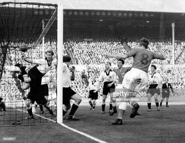 R Bentley scoring the winning goal for England against West Germany during an international match at Wembley London The final score was England 1...