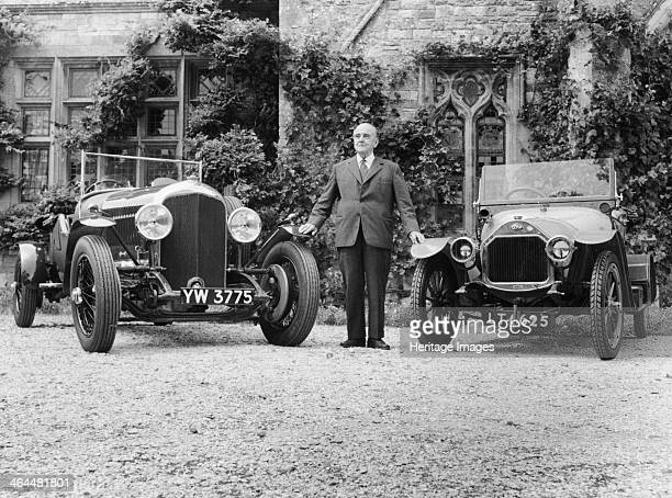 WO Bentley standing between two of his cars He started out working with his brother Horace for the London agency of the French DFP cars The Bentley...