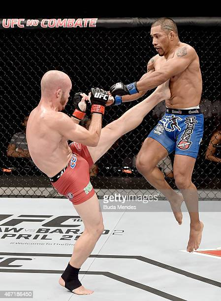 Bentley Syler of Bolivia kicks Fredy Serrano of Colombia in their flyweight bout during the UFC Fight Night at Maracanazinho Gymnasium on March 21,...