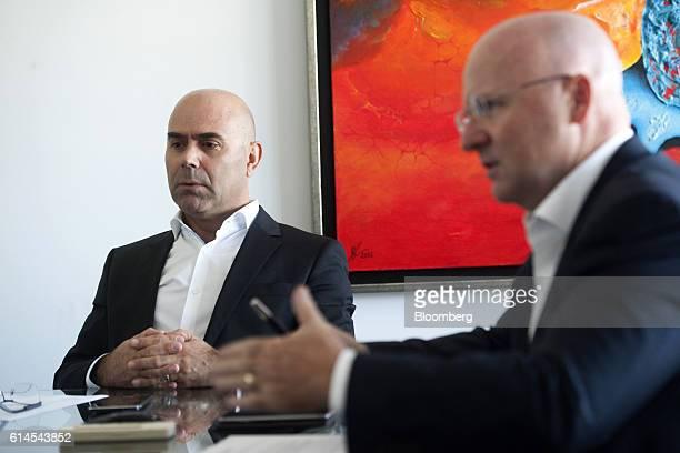 Bento Correia chairman of VisionBox Solucoes De Visao Por Computador SA left looks on as Miguel Leitmann chief executive officer of VisionBox...