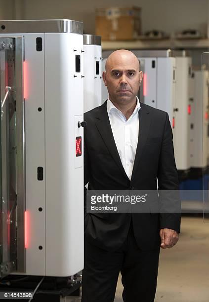 Bento Correia chairman of VisionBox Solucoes De Visao Por Computador SA poses for a photograph beside automated border control systems at their...