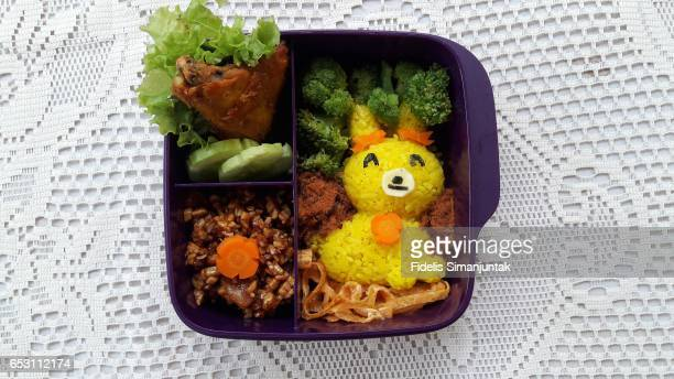 Bento set with cute rabbit-shaped yellow rice