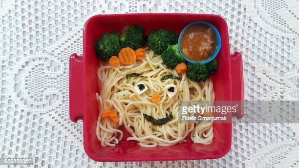 Bento set with smiley face-shaped spaghetti