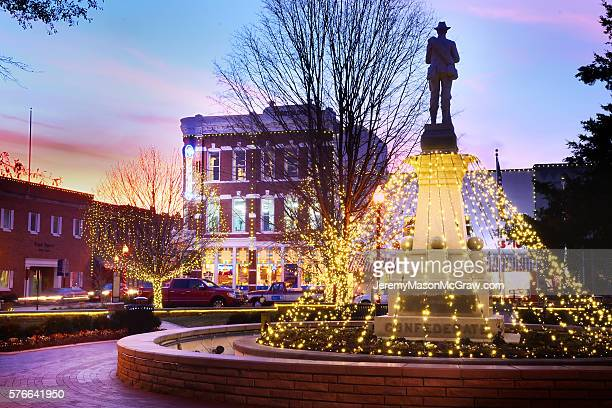 Bentonville Square Confederate Solder With Christmas Lights at Twilight