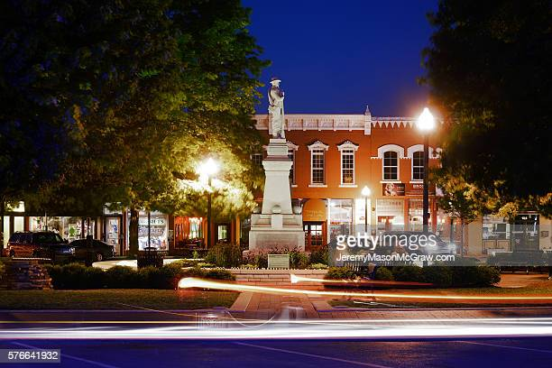 bentonville square confederate soldier statue at night - arkansas stock photos and pictures