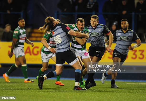Bentton Rugbys Giorgio Bronzini is tackled by Cardiff Blues' Kristian Dacey during the Guinness PRO12 Round 17 match between Cardiff Blues and...
