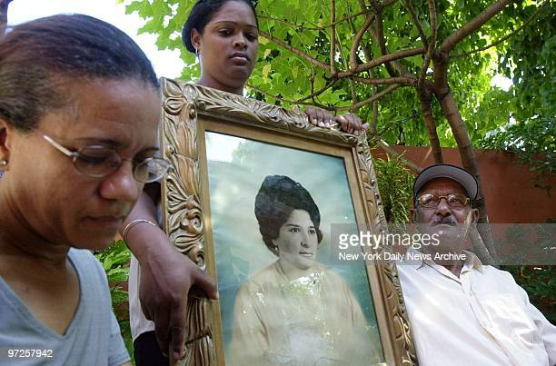 Benvenida Rocha holds a picture of aunt Gisela Coello with Coello's brother Julio Ricardo Coello and neighbor Mejaly Baro Gisela Coello died in the...