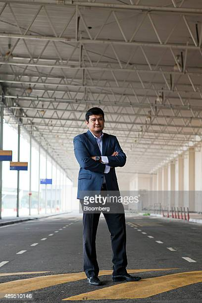 Benyamin Ismail chief executive officer of AirAsia X Bhd stands for a photograph outside the company's office at the disused Low Cost Carrier...
