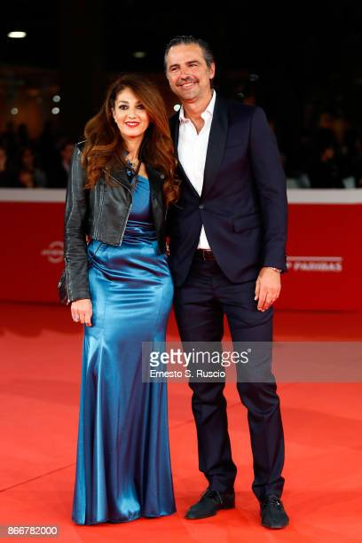 Beppe Convertini and a guest walk a red carpet for Hostiles during the 12th Rome Film Fest at Auditorium Parco Della Musica on October 26 2017 in...