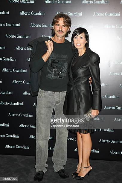 Beppe Convertini and Candida Morvillo attend the Alberto Guardiani Dance Chic Party on September 17, 2009 in Milan, Italy.