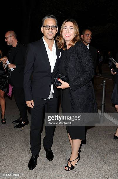 Beppe Fiorello and Eleonora Pratelli attend a dinner at the Dolce Gabbana Gold Restaurant as part Milan Womenswear Spring/Summer 2012 Fashion Week on...