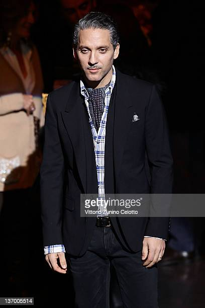 Beppe Fiorello poses on the runway prior the Dolce Gabbana fashion show as part of Milan Fashion Week Menswear Autumn/Winter 2012 on January 14 2012...