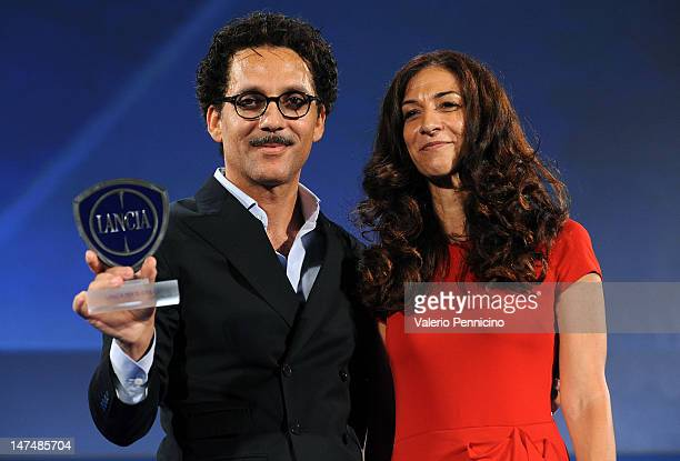 Beppe Fiorello receives the Lancia Award from Antonella Bruno Market Director Italy of Lancia Brand at Fiat Group during the 2012 Nastri d'Argento...
