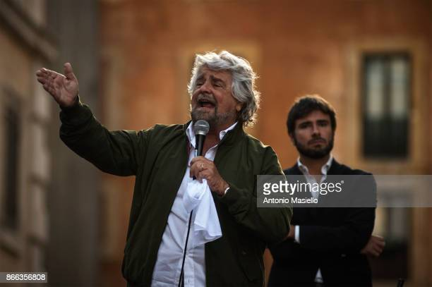 Beppe Grillo and Alessandro Di Battista speak during a protest organized by Five Star Movement in front of the Pantheon against the government's...