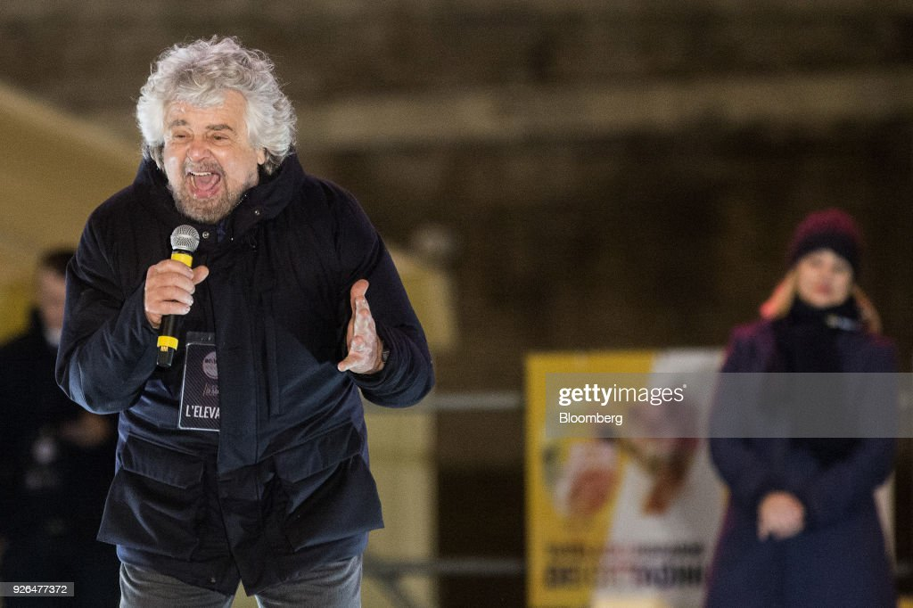 Beppe Grillo, comedian-turned-politician and founder of the Five Star Movement, speaks during a general election campaign rally for Luigi Di Maio, leader of Italy's anti-establishment Five Star Movement, not pitcured, in Rome, Italy, on Friday, March 2, 2018. Five Star says it will propose university professor Andrea Roventini as economy minister if the movement wins enough votes to form a government in March 4 elections, Di Maio said. Photographer: Alessia Pierdomenico/Bloomberg via Getty Images