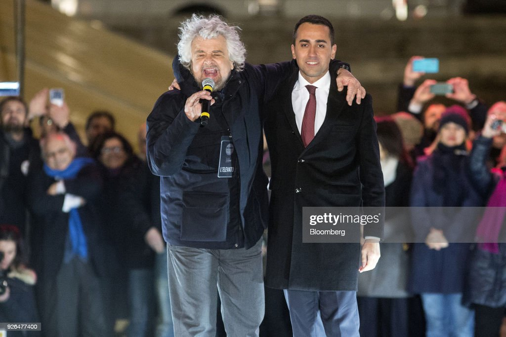 Beppe Grillo, comedian-turned-politician and founder of the Five Star Movement, speaks during a general election campaign rally with Luigi Di Maio, leader of Italy's anti-establishment Five Star Movement, in Rome, Italy, on Friday, March 2, 2018. Five Star says it will propose university professor Andrea Roventini as economy minister if the movement wins enough votes to form a government in March 4 elections, Di Maio said. Photographer: Alessia Pierdomenico/Bloomberg via Getty Images