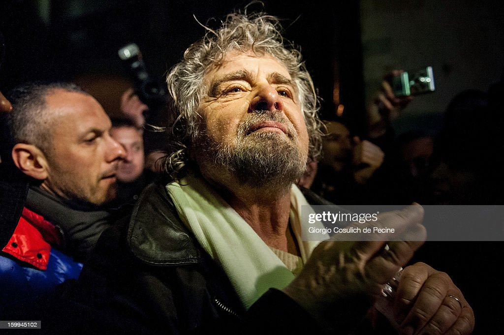 Beppe Grillo, founder of the Movimento 5 Stelle (Five Star Movement), leaves after a public rally for the political campaign on January 23, 2013 in Pomezia, Italy. Grillo is touring all over Italy to promote the Five Star Movement at the next elections.