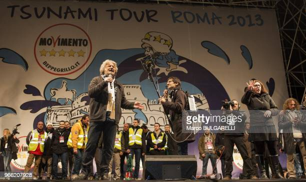 Beppe Grillo leader of the Five Star Movement speaks with a supporter woman after his last political rally before the national election on February...