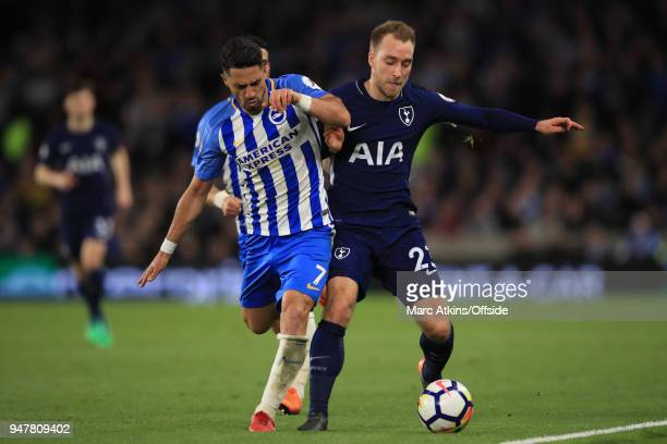 Beram Kayal of Brighton and Hove Albion in action with Christian Eriksen of Tottenham Hotspur during the Premier League match between Brighton and...