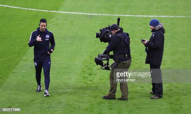 Beram Kayal of Brighton and Hove Albion is filmed by a TV cameraman as he walks on the pitch prior to the Premier League match between Brighton and...