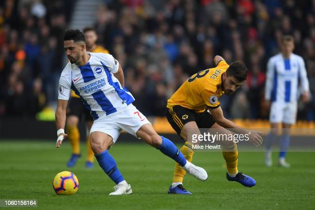 Beram Kayal of Brighton Hove Albion gets past Ruben Neves of Wolverhampton Wanderers during the Premier League match between Brighton Hove Albion and...