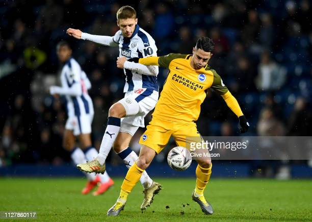 Beram Kayal of Brighton Hove Albion is challeneged by Sam Field of West Bromwich Albion during the FA Cup Fourth Round Replay match between West...