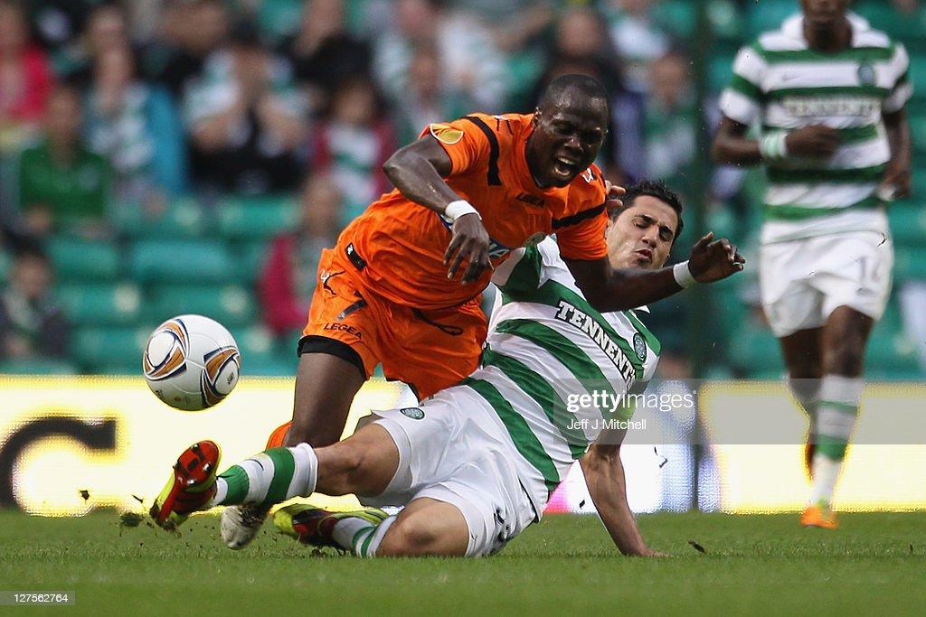 Beram Kayal of Celtic tackles Emmanuel Badu of Udinese during the Europa League Group I match between Celtic and Udinese at Celtic Park on September 29, 2011 in Glasgow, United Kingdom.