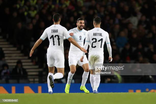 Beram Kayal of Israel celebrates with team mates Loai Taha and Munas Dabbur after scoring his team's first goal during the UEFA Nations League C...