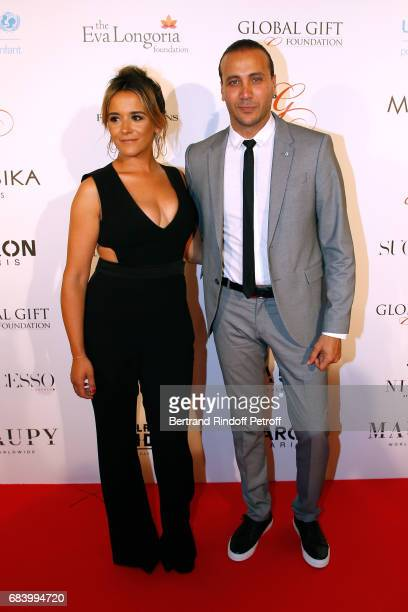 Berangere Nogues and Merwan Rim attend the Global Gift the Eva Foundation Gala Photocall at Hotel George V on May 16 2017 in Paris France
