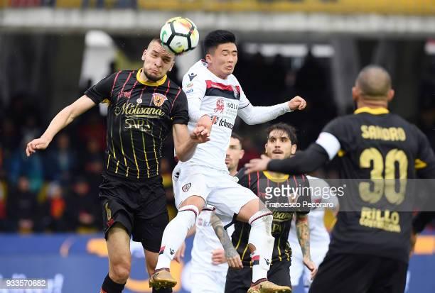 Berat Djimsiti of Benevento Calcio vies with KwangSong Han of Cagliari Calcio during the serie A match between Benevento Calcio and Cagliari Calcio...