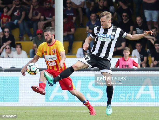 Berat Djimsiti of Benevento Calcio vies with Silvan Widmer of Udinese Calcio during the serie A match between Benevento Calcio and Udinese Calcio at...