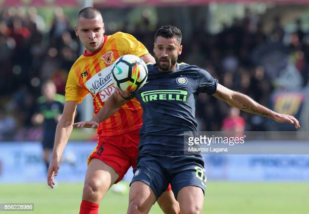 Berat Djimsiti of Benevento competes for the ball with Antonio Candreva of Inter during the Serie A match between Benevento Calcio and FC...