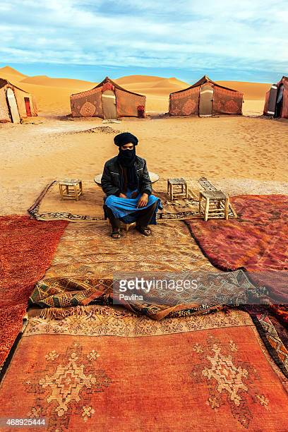 berber guide sits in the camp in the sahara desert - tuareg tribe stock pictures, royalty-free photos & images