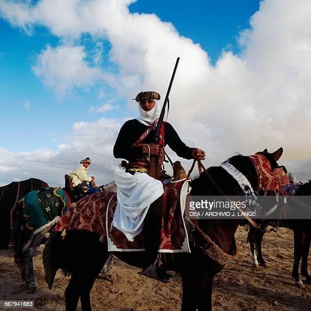 Berber horseman with rifle Berber festival Douz Tunisia