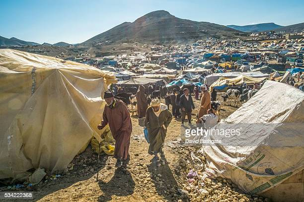 Berber men walk through a livestock market at the Imilchil Morocco Marriage and Betrothal Festival