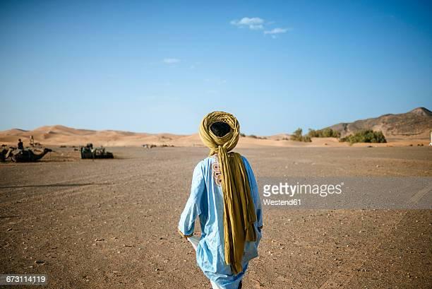 Berber walking in desert
