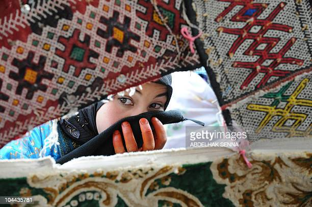 A berber woman attends a group wedding ceremony in high Atlas Mountain the Berber village of Imilchil on September 23 2010 Once a year in September a...